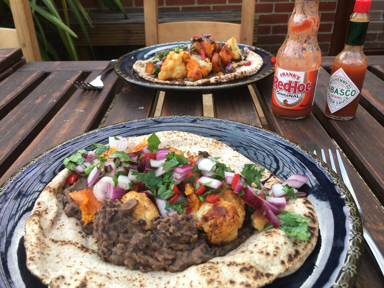 Cauliflower, sweet potato and black bean wraps with coriander, onion and chilli salsa
